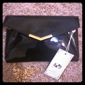 Patented blk wristlet/small cute purse